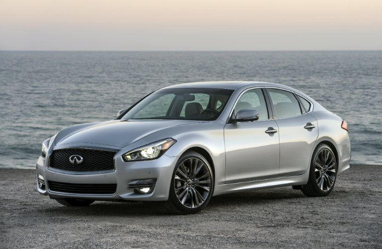 silver infiniti q70 parked by water
