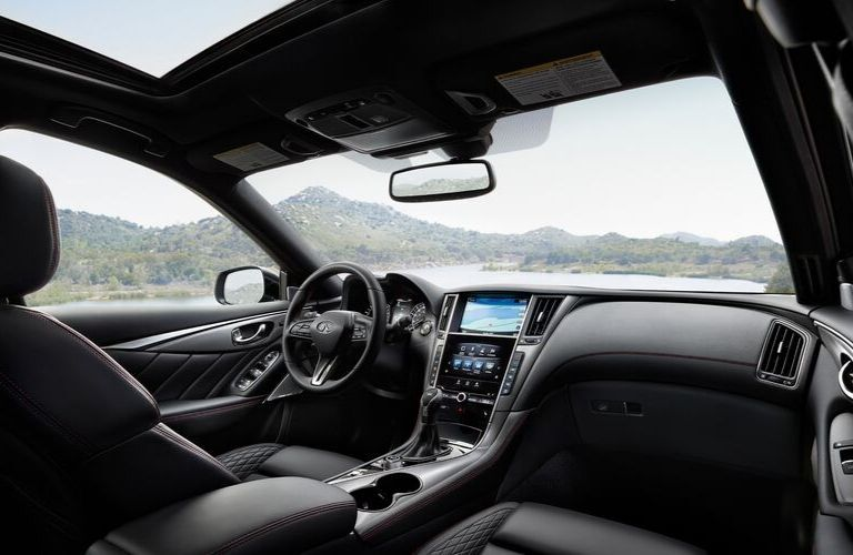 Interior view of the front seating area inside a 2020 INFINITI Q50
