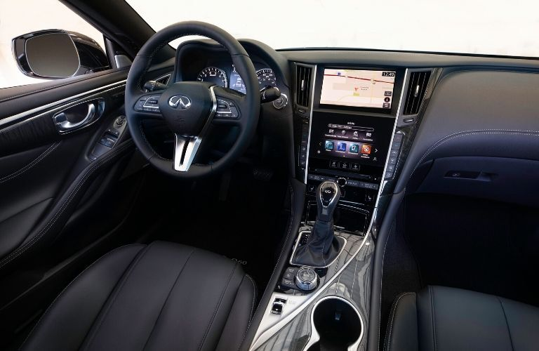 Interior view of the front seating area inside a 2020 INFINITI Q60