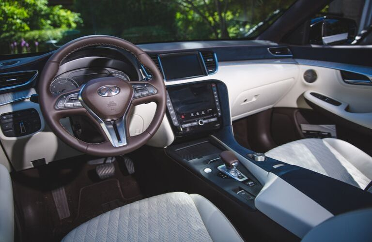 Interior view of the front seating area inside a 2020 INFINITI QX50