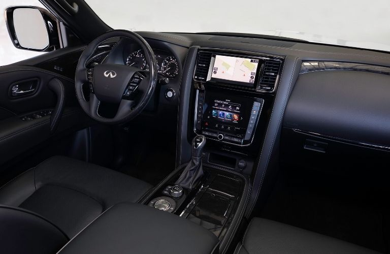 Interior view of the front seating area inside a 2020 INFINITI QX80