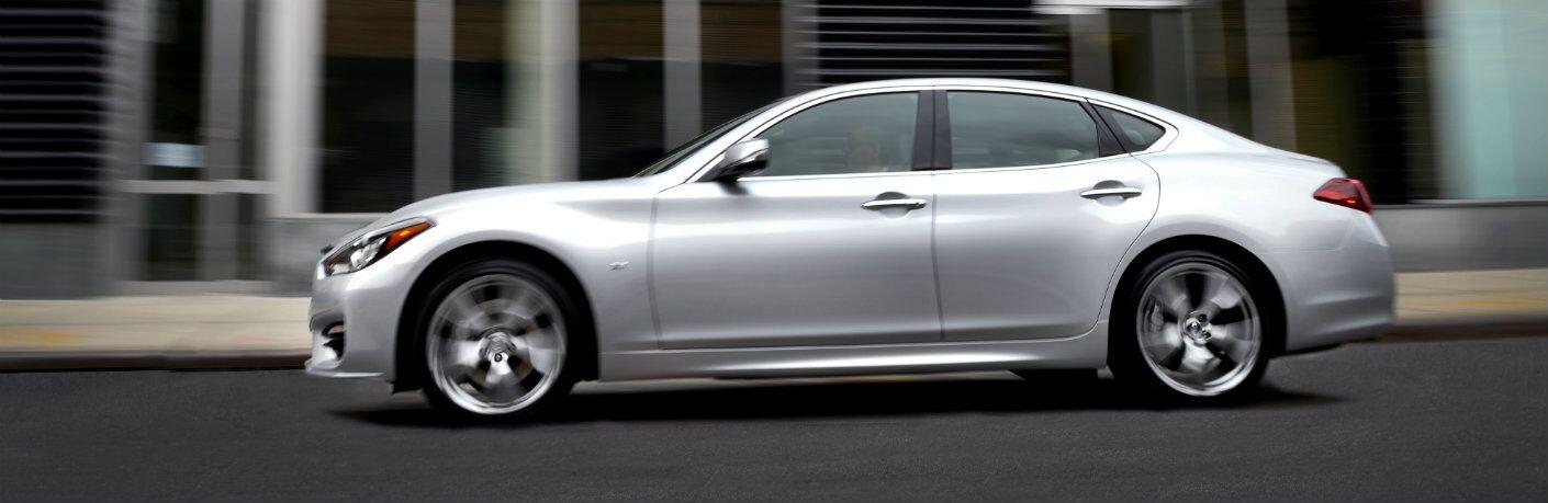 silver infiniti q70 driving