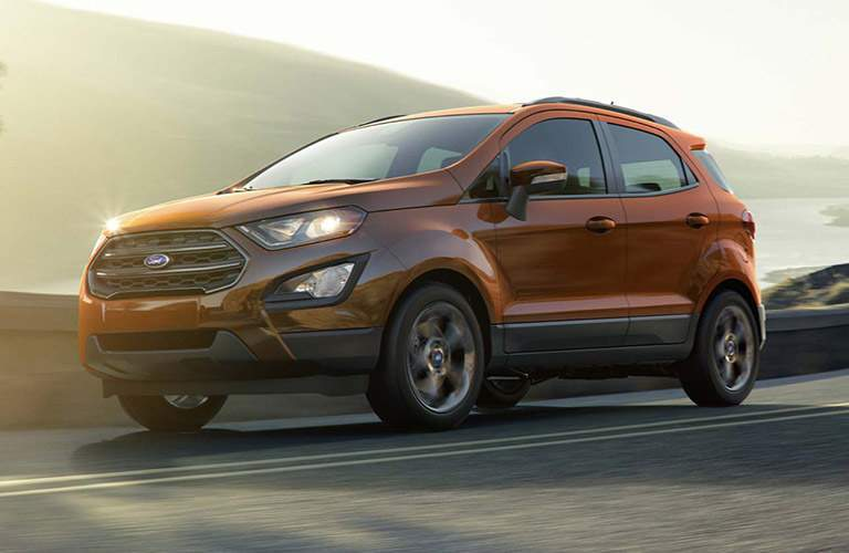 2018 Ford EcoSport driving on a highway with a gray cloudy sky