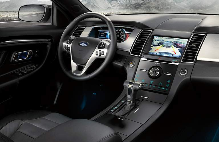 Interior of the 2018 Ford Taurus with focus on the steering wheel and display in black