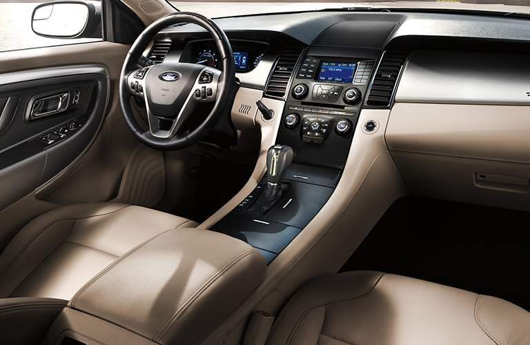 Front seats of the 2018 Ford Taurus with focus on the center console in tan