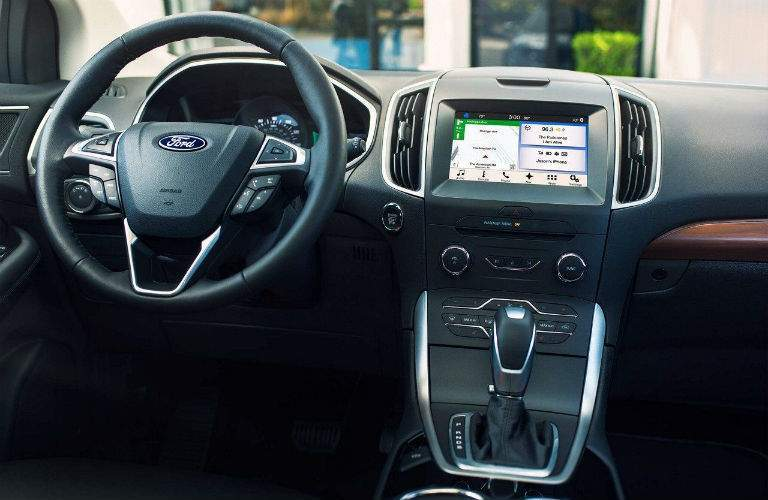 Interior cockpit of the 2018 Ford Edge with focus on the steering wheel and the infotainment system