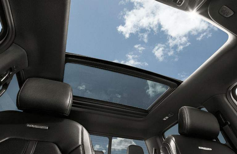 2018 ford f 150 platinum moonroof option showing sun shining through open moonroof in norwood ma