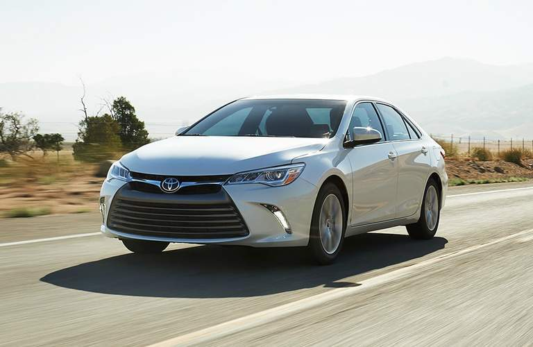 silver 2017 Toyota Camry driving on open road