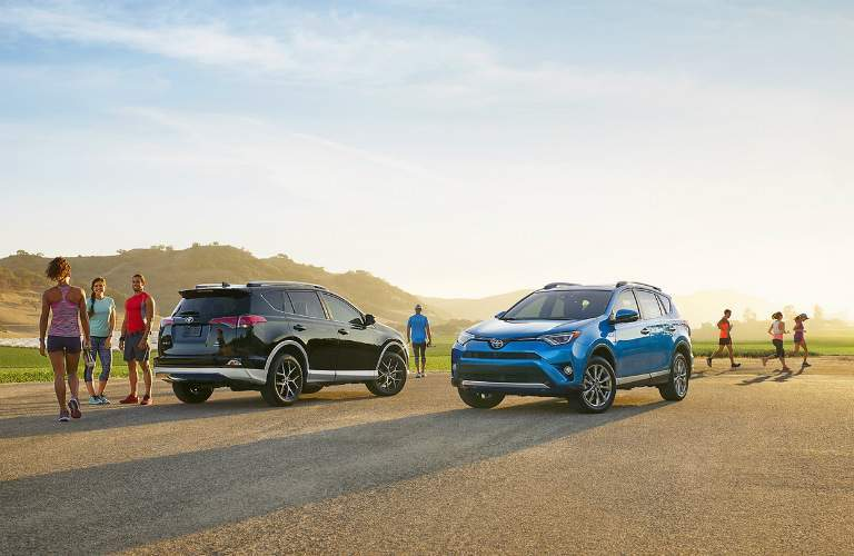 people parking their 2017 and black 2017 Toyota RAV4 models side by side