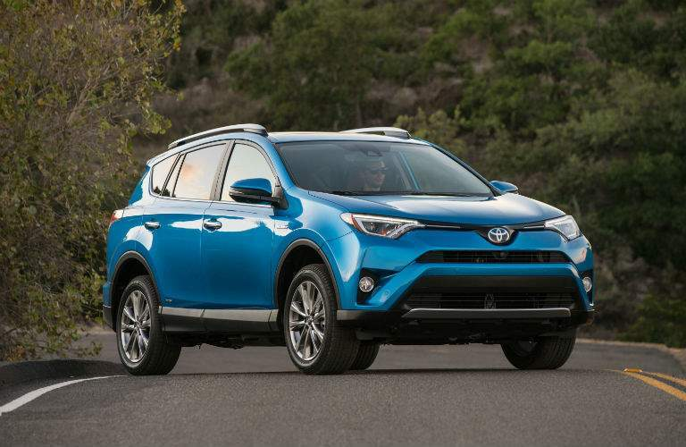 Passenger side view of a blue 2018 Toyota Rav4
