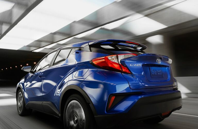 blue 2018 Toyota C-HR driving through tunnel