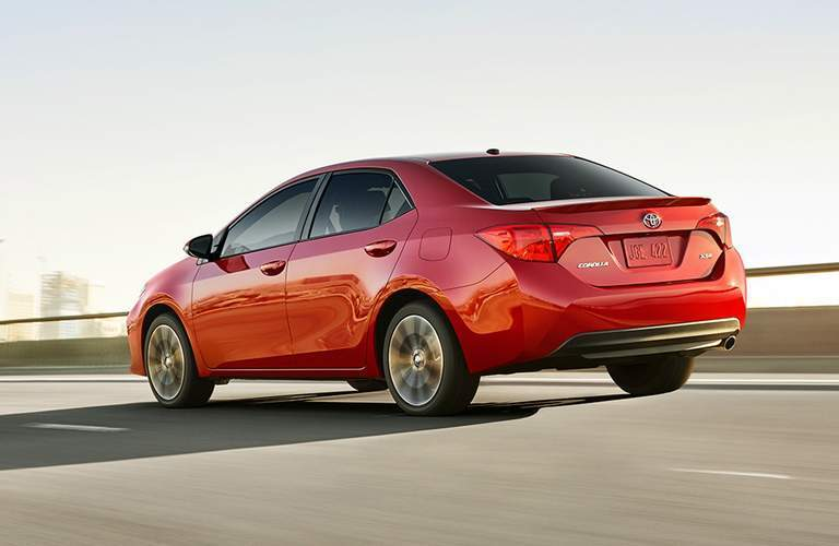 red 2018 Toyota Corolla driving on highway