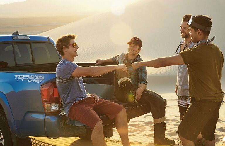 Four men on vacation in their 2017 Toyota Tacoma
