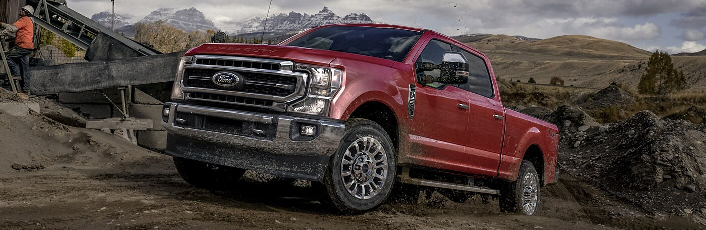 red 2020 ford f-250 super duty climbing a hill