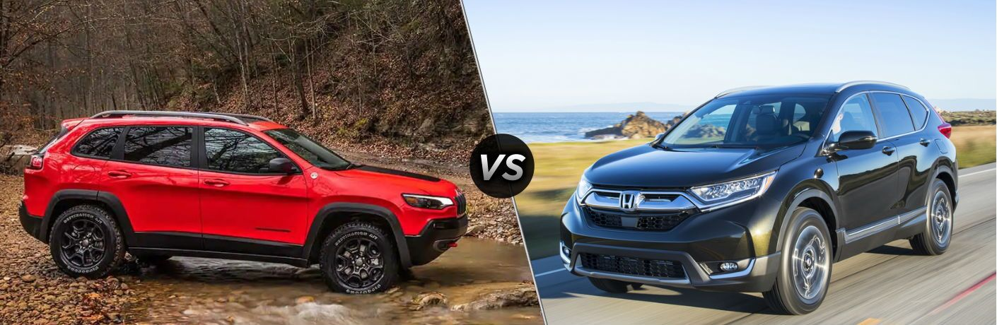 """Passenger side exterior view of a red 2019 Jeep Cherokee on the left """"vs"""" front driver side exterior view of a black 2019 Honda CR-V on the right"""