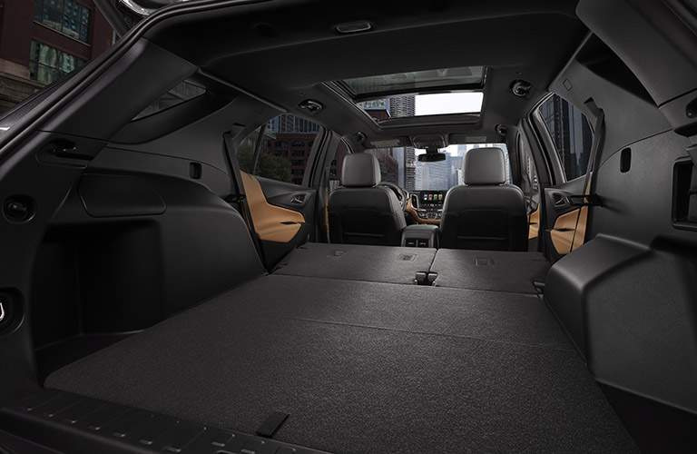 Rear seats folded flat for storage in the 2018 Chevy Equinox