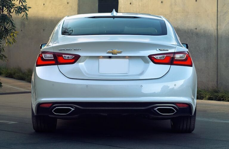 Rear exterior view of a white 2018 Chevy Malibu