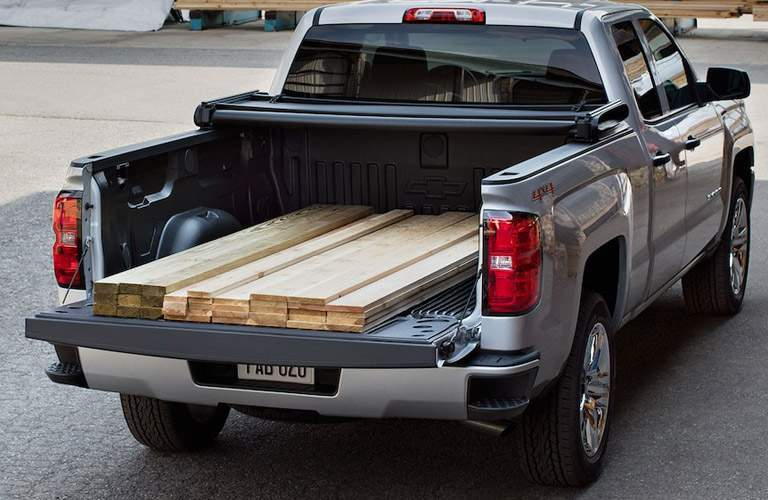 2018 Chevy Silverado's bed loaded with lumber