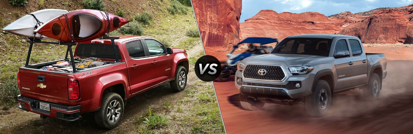 "Passenger side exterior view of a red 2018 Chevy Colorado on the left ""vs"" a driver side exterior view of a gray 2018 Toyota Tacoma on the right"