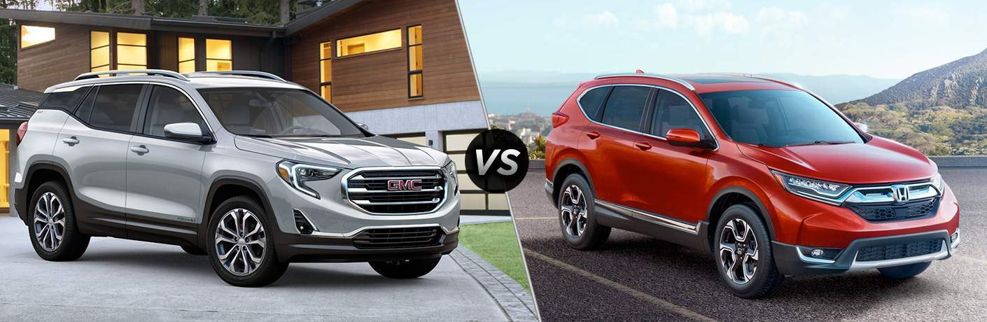 "Passenger side exterior view of a gray 2018 GMC Terrain on the left ""vs"" passenger side exterior view of a red 2018 Honda CR-V on the right"