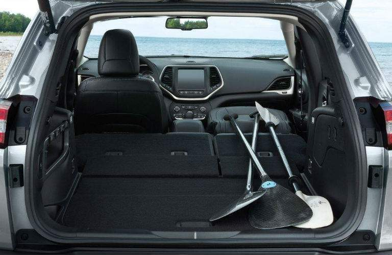 Rear seat and front passenger seat folded down in the 2018 Jeep Cherokee to accommodate kayak oars