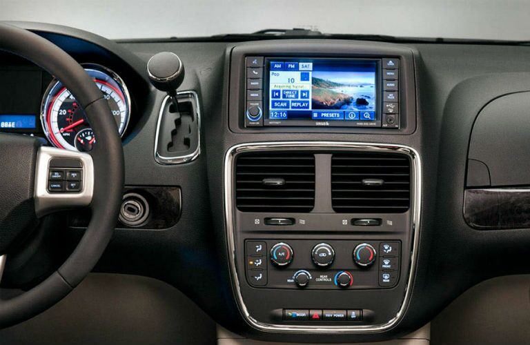Touchscreen display and temperature controls of  the 2018 Dodge Caravan