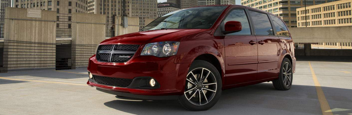 Driver's side exterior view of a red 2018 Dodge Grand Caravan