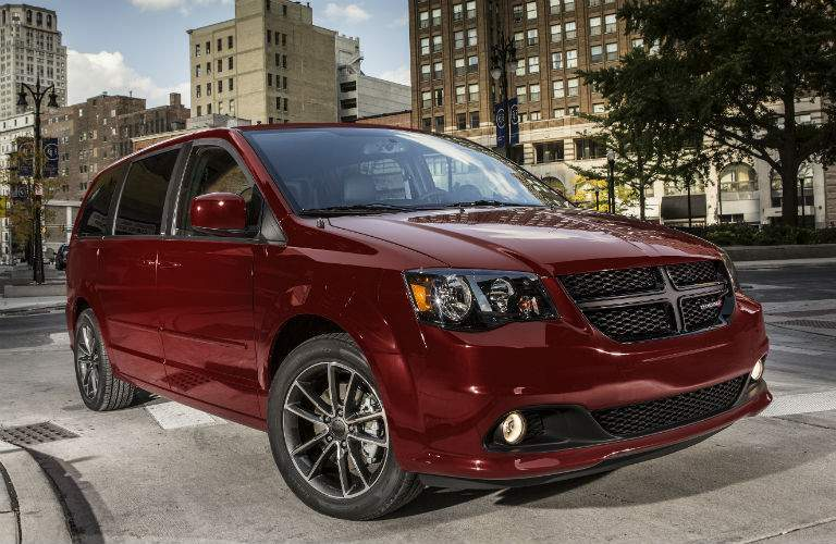 Passenger side exterior view of red 2018 Dodge Caravan