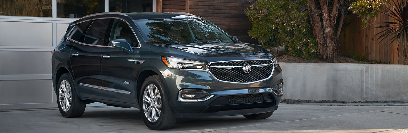 Front passenger side exterior view of a gray 2019 Buick Enclave