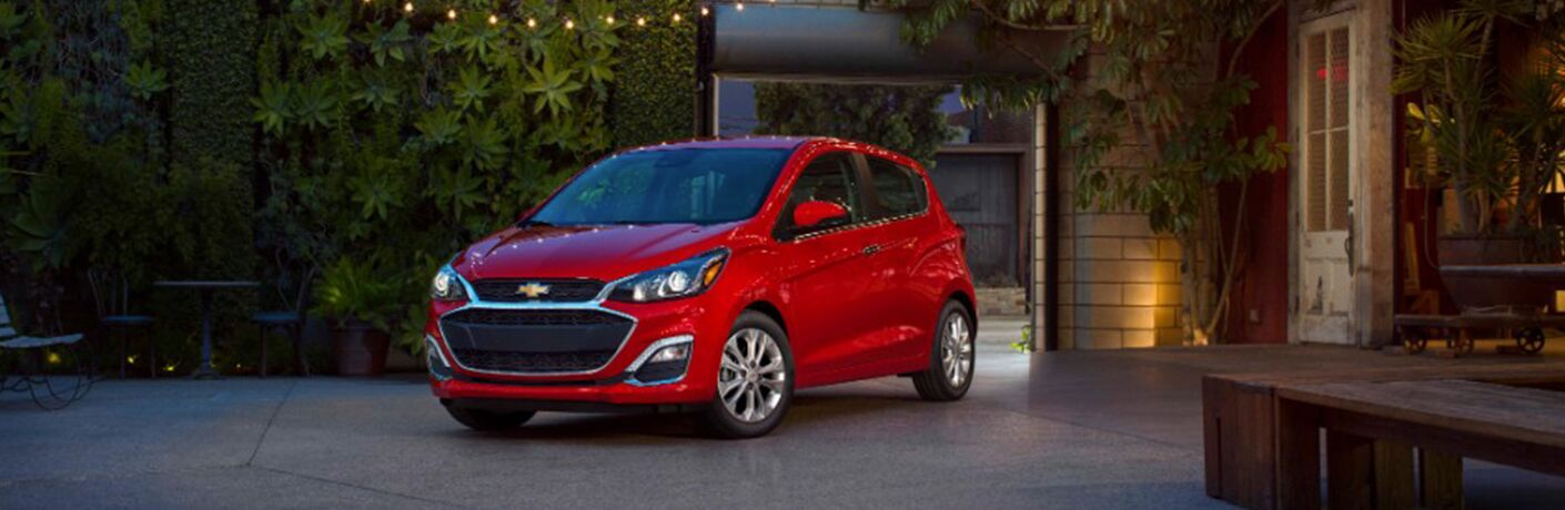 Front driver side exterior view of a red 2019 Chevy Spark