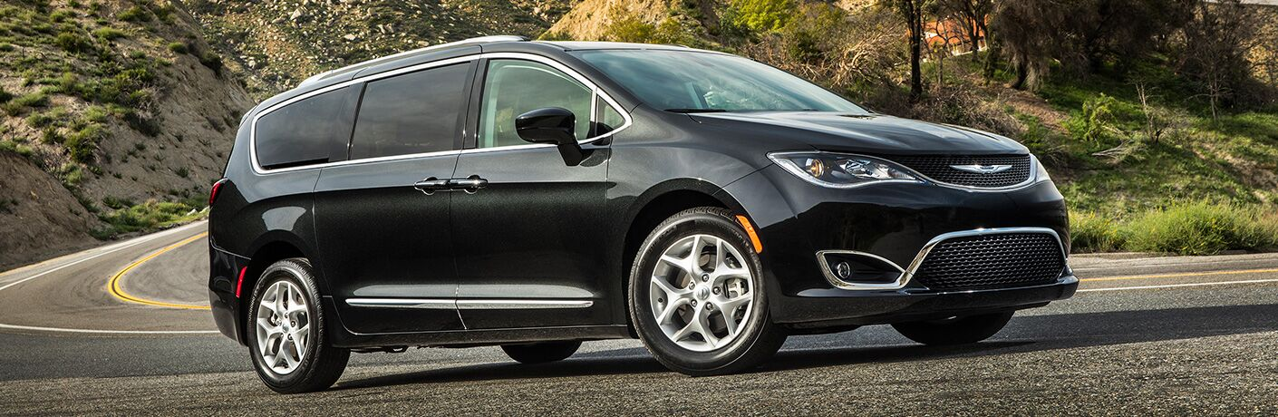 Passenger side exterior view of a black 2019 Chrysler Pacifica