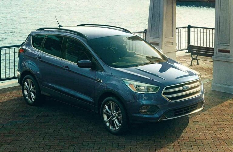 Exterior view of a blue 2019 Ford Escape parked near a body of water