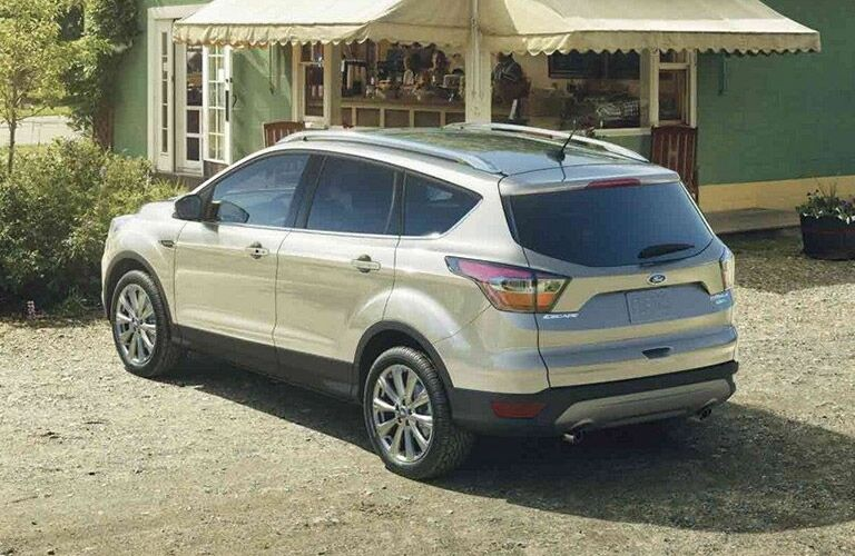 Rear driver side exterior view of a white 2019 Ford Escape