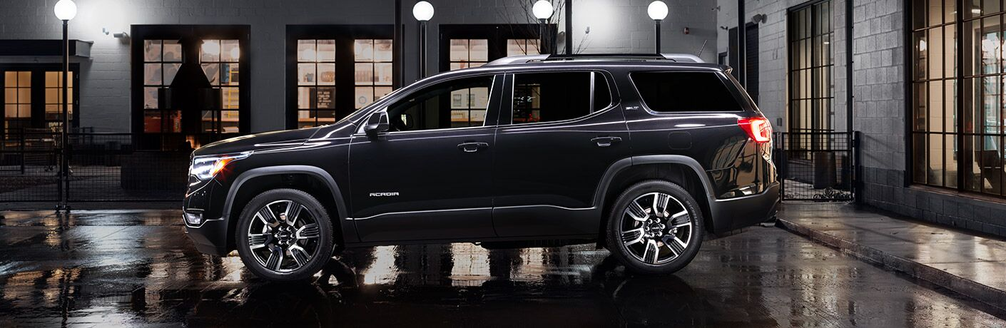 Driver side exterior view of a black 2019 GMC Acadia