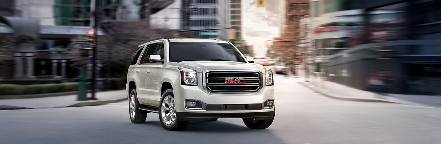 2019 GMC Yukon driving in a big city