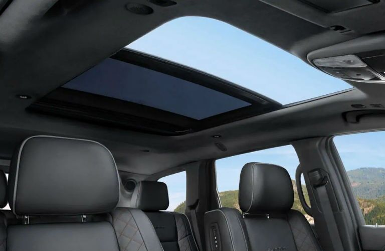 Looking out the available sunroof of the 2019 Jeep Grand Cherokee