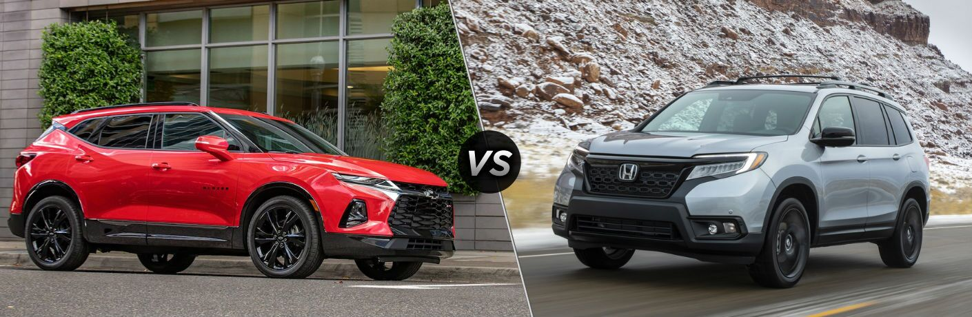 """Passenger side exterior view of a red 2019 Chevy Blazer on the left """"vs"""" front driver side exterior view of a gray 2019 Honda Passport on the right"""