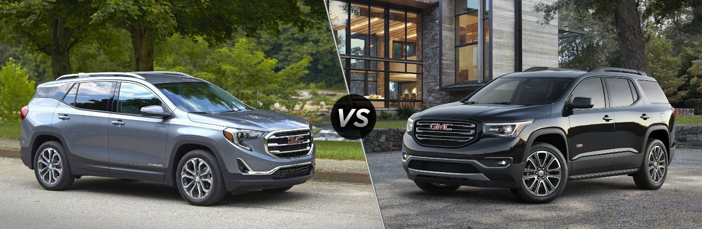 "Passenger side exterior view of a gray 2019 GMC Terrain on the left ""vs"" driver side exterior view of a black 2019 GMC Acadia on the right"