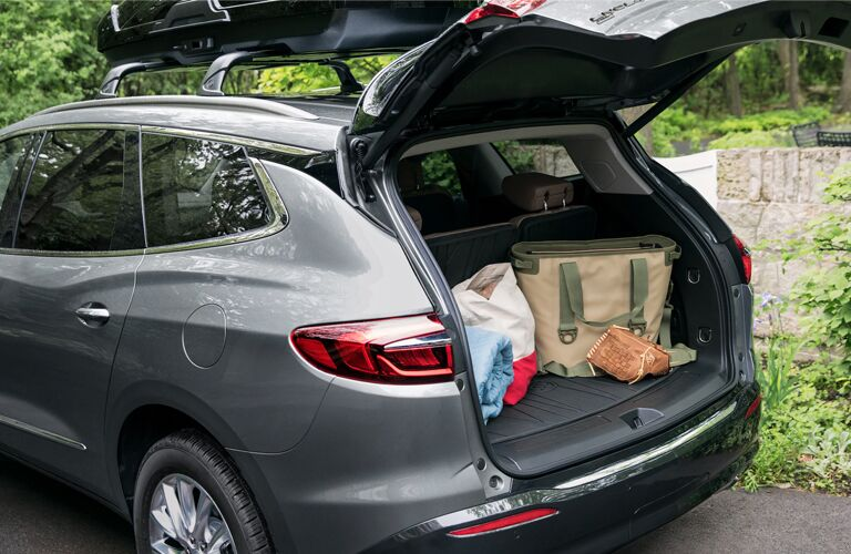 Bags in the cargo area of a grey 2020 Buick Enclave