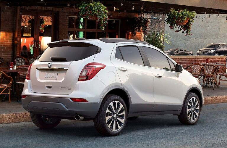 White 2020 Buick Encore parked next to an outdoor dining area