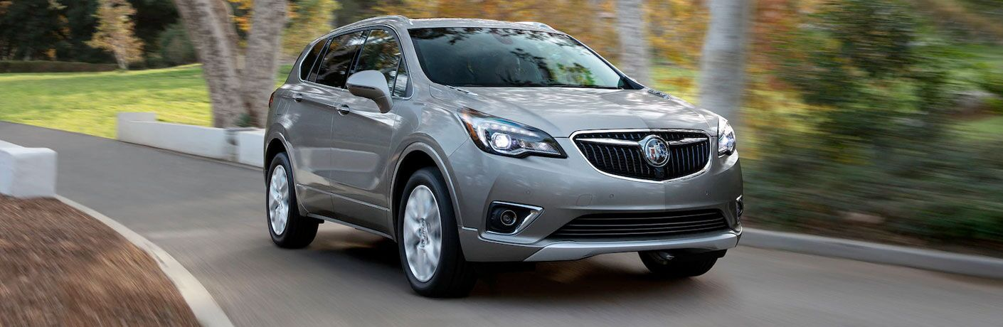Passenger's side front angle view of grey 2020 Buick Envision