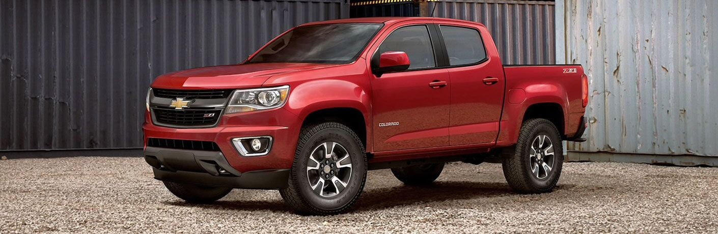 Red 2020 Chevrolet Colorado parked near some shipping containers