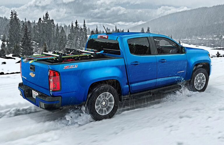 Blue 2020 Chevrolet Colorado driving on snowy terrain