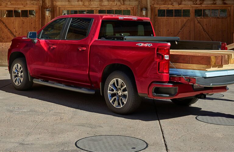 2020 Chevy Silverado getting loaded up with wooden planks and poles