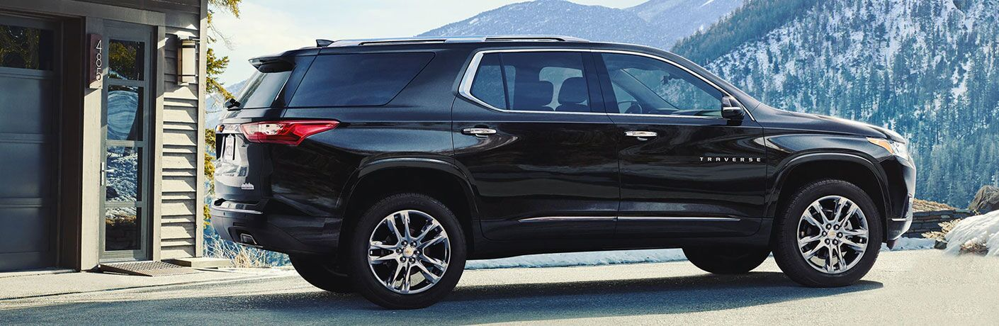 Black 2020 Chevrolet Traverse with snowy mountains in the background