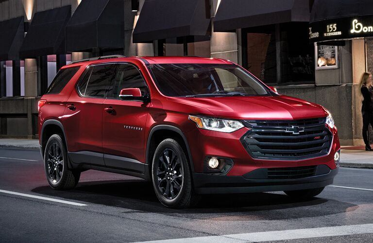 Passenger's side front angle view of red 2020 Chevrolet Traverse