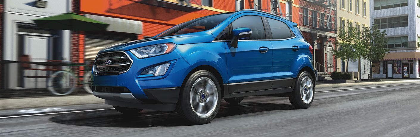 Blue 2020 Ford EcoSport driving on a city street