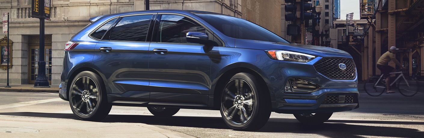 blue 2020 Ford Edge turning a corner in the city