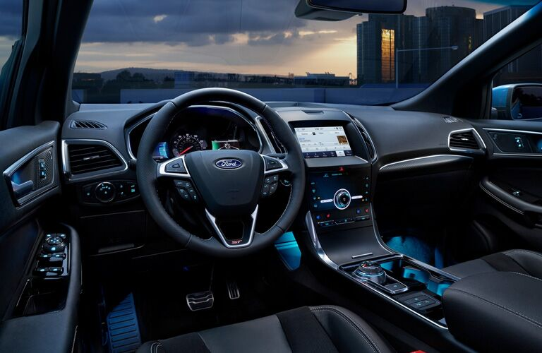 2020 Ford Edge interior steering wheel and dashboard with twilight outside the windshield