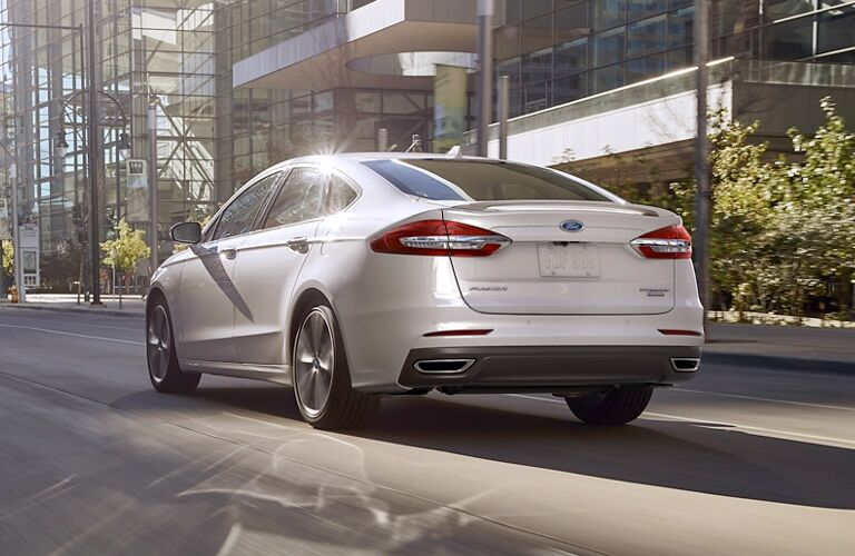 2020 Ford Fusion exterior rear quarter view as it drives down a street